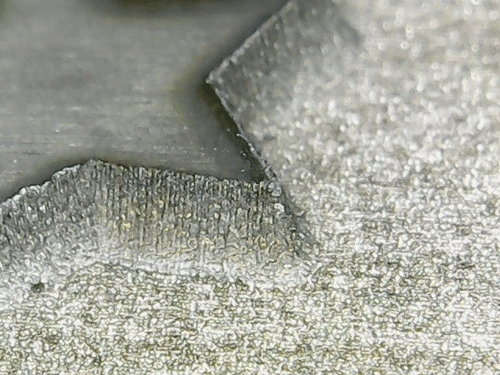 Close-up view of deep engraving on steel