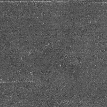 The bare aluminum before laser engraving, viewed using an electron microscope. The surface is rather smooth.