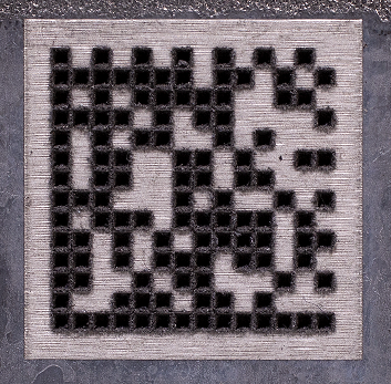 Laser engraved data matrix code with black and white cells.
